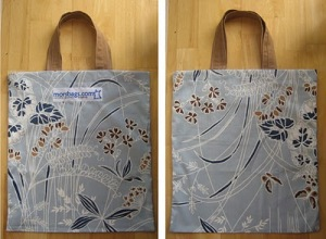 a morsbag, front and back picture. A blue background with a swirly dark blue, white and brown overlay